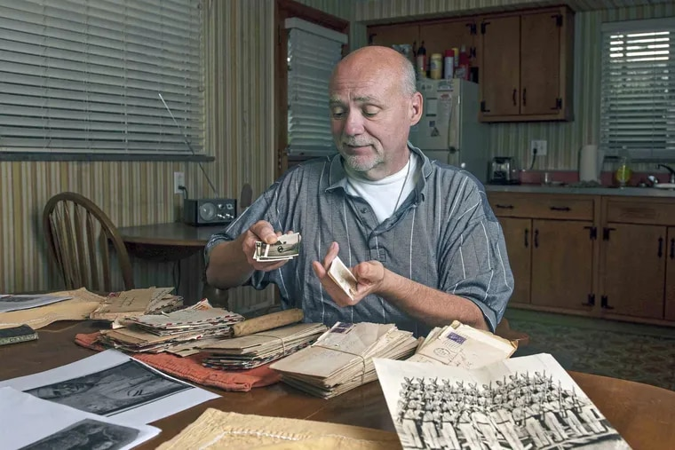 David Wassel, an attorney from White Oak, Allegheny County, looks at old letters his great-uncle Harry Dininger sent to Harry's mother, Grace,  while he was serving in the Pacific Theatre during World War II.