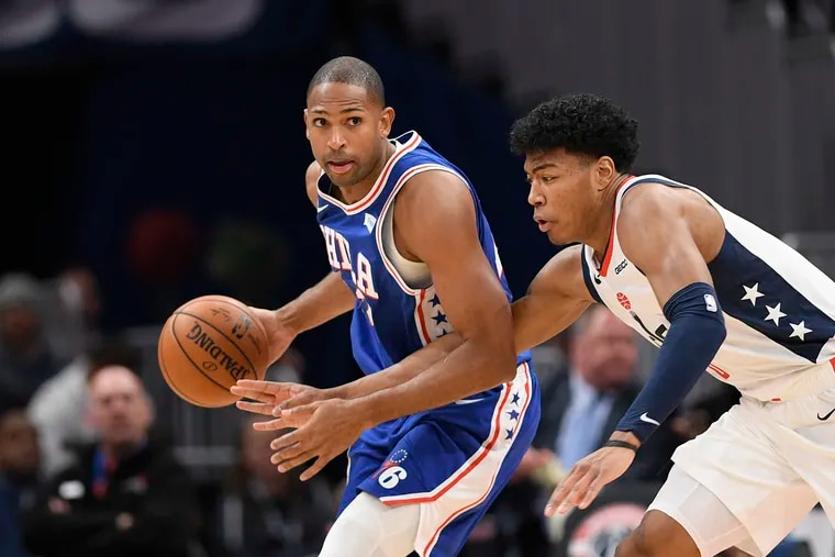 Al Horford, left, and his Sixers teammates are 5-7 on the road this season.