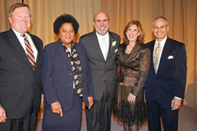 At the Anti-Defamation League's annual benefit dinner: (from left) Bill Mills, the event's general chairman; Charisse Lillie, mistress of ceremonies; honoree Joe Frick, of Independence Blue Cross; Roberta Liebenberg, ADL board chair; Barry Morrison, ADL regional director.