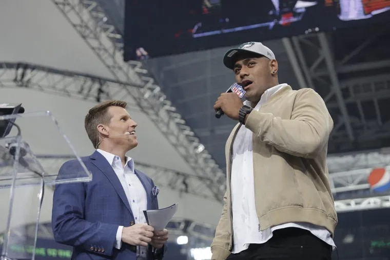 Australian rugby player Jordan Mailata, right, appears onstage after being selected by the Eagles in the seventh round of the NFL draft on Saturday.