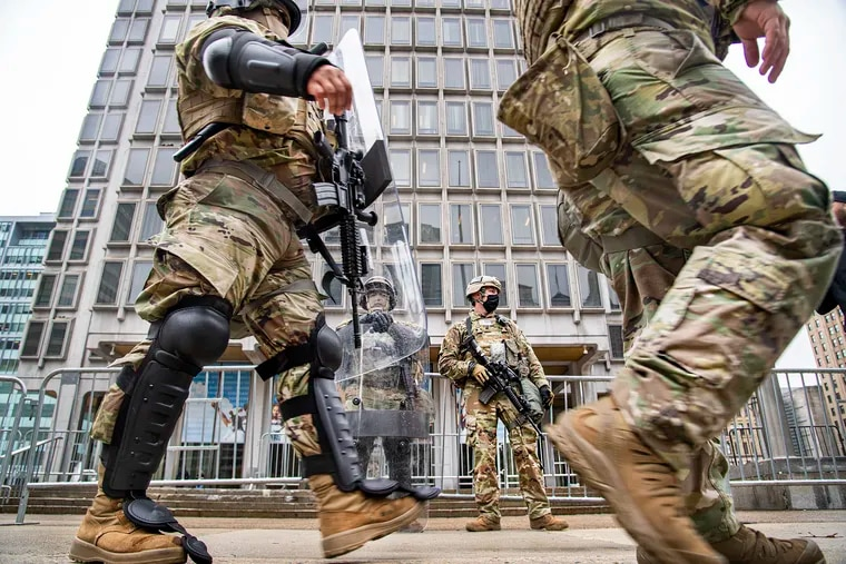 Members of the National Guard stand in guard in front of the Philadelphia Municipal Services Building in Philadelphia, Pa. Friday, October 31, 2020.