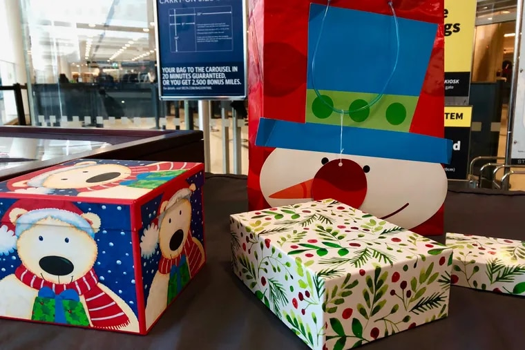 TSA recommends boxes and bags over wrapped Christmas gifts at Philadelphia International Airport.