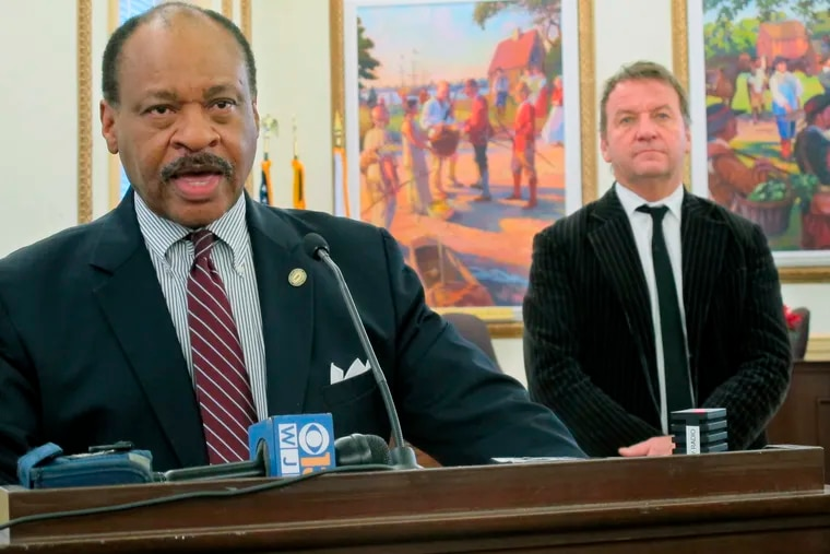 Carl Snowden speaks at a news conference to discuss a fund-raising effort and plans for a contest to select a memorial concept to honor the five people who were killed in the Capital Gazette newspaper shooting this summer as Annapolis Mayor Gavin Buckley stands behind, Thursday, Dec. 20, 2018, in Annapolis, Md.