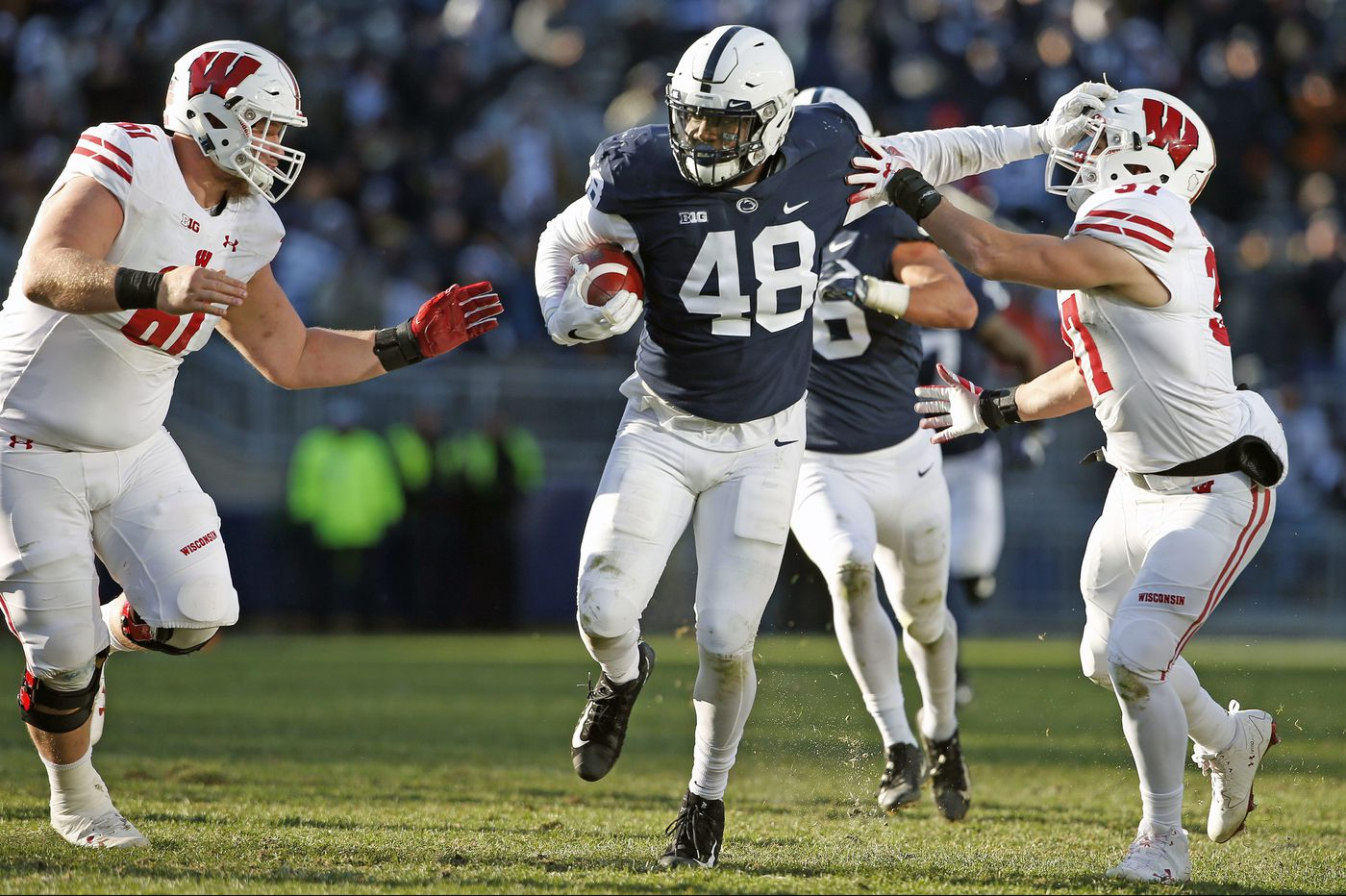 Penn State's Shareef Miller finds some unpleasantness while trying to claim a fumble against Rutgers