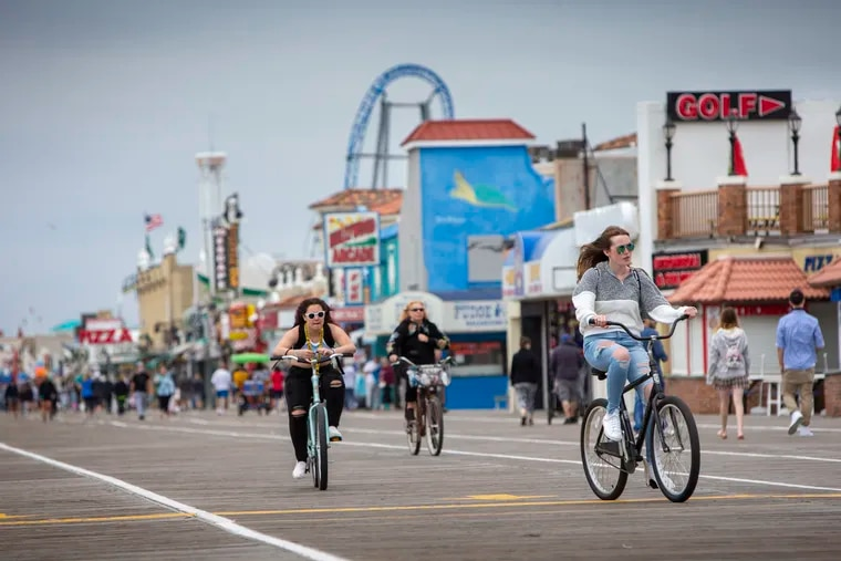 Many pandemic-weary folks welcome the freedom that the CDC says comes with vaccination. In Ocean City, bicyclists shed their masks and enjoyed the boardwalk on May 24, 2021.