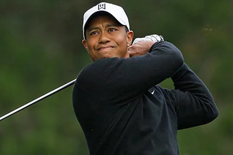 Tiger Woods practiced at Pebble Beach yesterday. He won the 2000 U.S. Open there by 15 strokes. (David J. Phillip/AP)