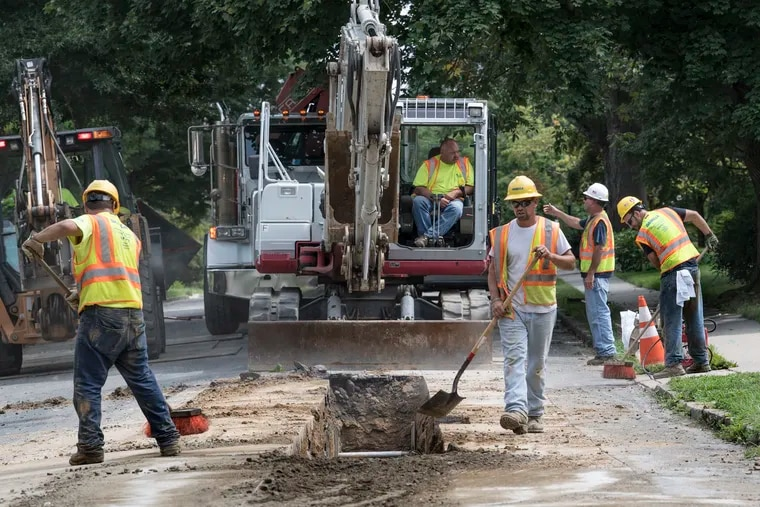 Aqua Pennsylvania workers rebuild a water main in 2018 in Upper Darby. The Bryn Mawr water utility has filed for a 17.9% rate increase to recover $1.1 billion in infrastructure costs it has invested in recent  years.