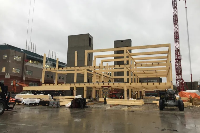Construction of the four-story CLT hybrid Wilson School of Design in Richmond, British Columbia. The building went up last year; these photos show the glue-laminated post-and-beam framing on concrete foundation. Later, cross-laminated timber decking and glass curtain walls were added.