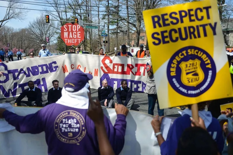 A 32BJ SEIU rally for security guards in 2018. The union says that several institutions are not following the city's prevailing wage law and paying its security guards $15 an hour.