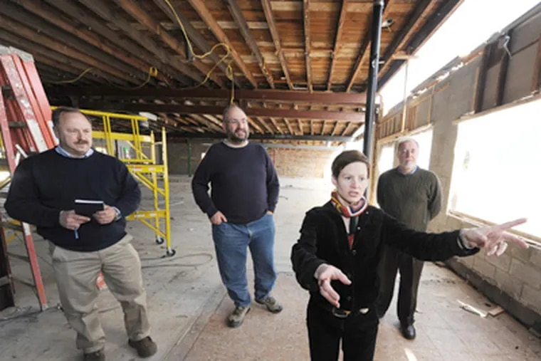 Greta Millis (front), Creekside project manager, tours the site with (from left) contractor Joe Zajaczkowski and the co-op's Max Minkoff and Fred Milbert. (Clem Murray / Staff Photographer)