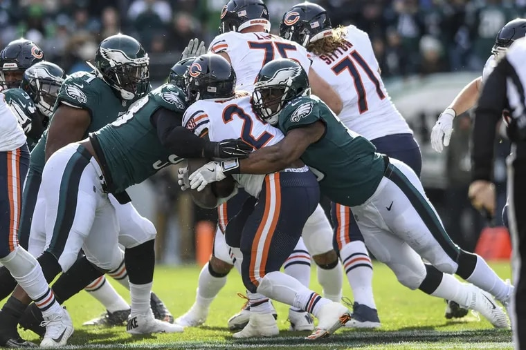 Eagles defensive linemen Tim Jernigan (left) and Brandon Graham (right) stop Chicago running back Jordan Howard for a 1-yard loss on 3rd and 2 in the 1st quarter of the game November 26, 2017 at Lincoln Financial Field. Eagles won 31-3.