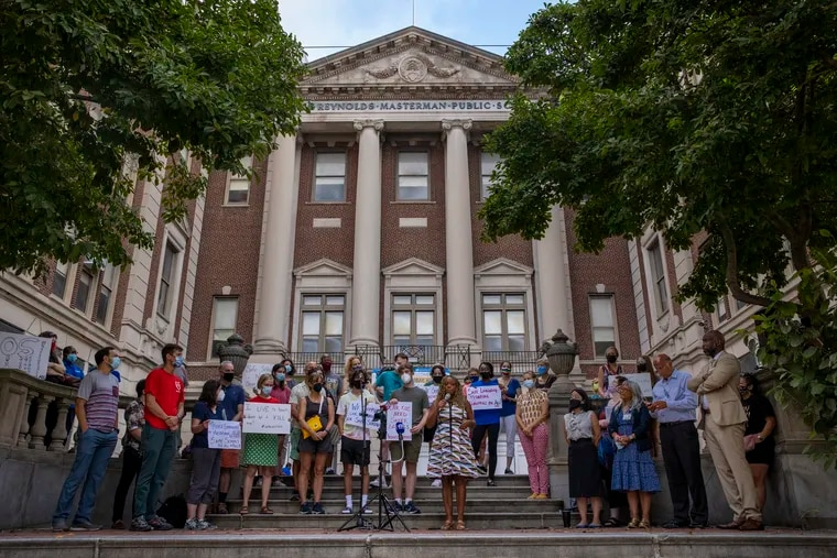 """Masterman parents hold a press conference outside the school at 17th and Spring Garden in support of teachers in regards to asbestos and the """"district's broken promises"""" on Monday morning, Aug. 30, 2021."""