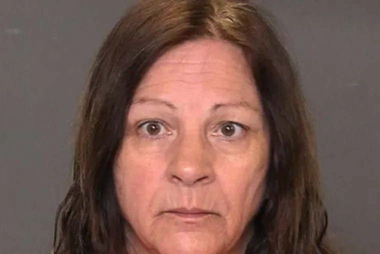 Police photo of Jo Crosby, the mother accused of helping son conceal Mt. Laurel murder.