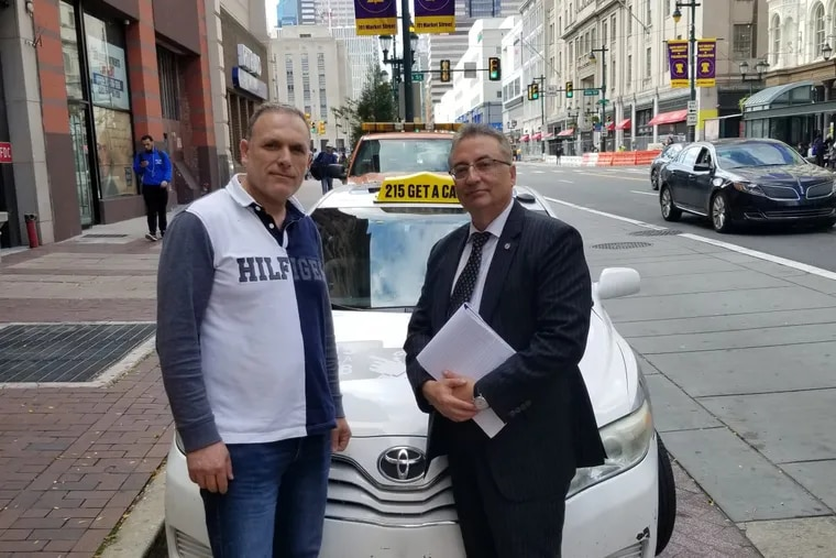 Cab driver Pierre Haifa (left) worries that the new cooperation among cab companies will increase competition. Haifa's lawyer, Eli Gabay (right), is trying to find a resolution.