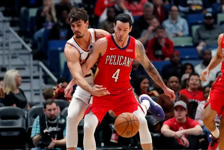 Pelicans guard JJ Redick (4) battling another former Sixer, Phoenix forward Dario Saric, during a game last week.