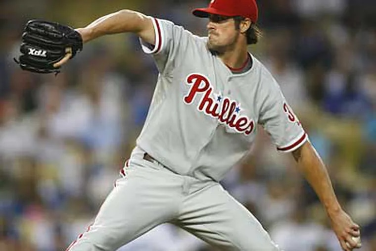 Cole Hamels pitches in the second inning against the Los Angeles Dodgers on Tuesday. (Gus Ruelas/Associated Press)