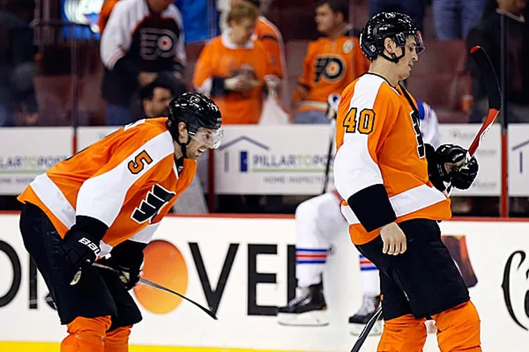 The Flyers' Vincent Lecavalier and Braydon Coburn. (Yong Kim/Staff Photographer)