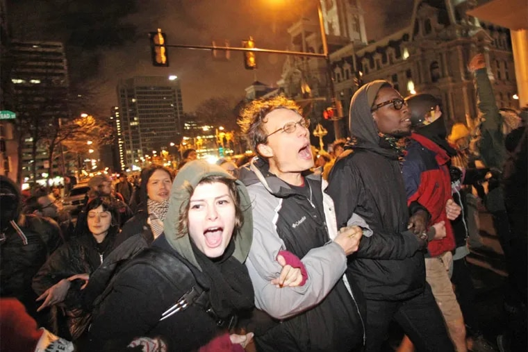 Occupy Philadelphia protesters leave Dilworth Plaza and head towards Walnut St. in this 2011 photo.