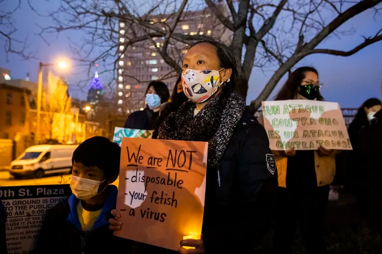 Melissa Min and her son James attend a candlelit vigil held by Philly's Asian American leaders on March 17, 2021, to honor victims of the Atlanta shooting and to speak against hate.