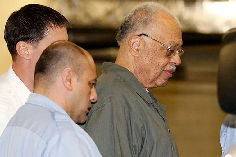 Dr. Kermit Gosnell gets escorted to a van leaving the Criminal Justice Center after getting convicted on three counts of first degree murder on Monday, May 13, 2013.  ( Yong Kim / Staff Photographer )