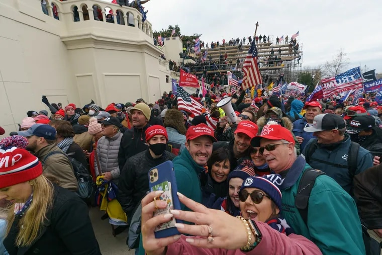"""Trump supporters outside the U.S. Capitol building after a """"Stop the Steal"""" rally on Jan. 6."""