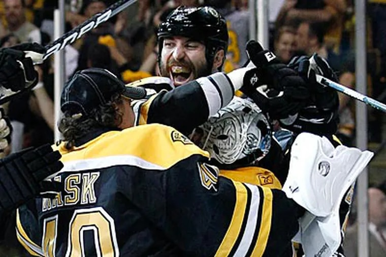 The Boston Bruins will play in their first Stanley Cup since 1990. (Elise Amendola/AP)