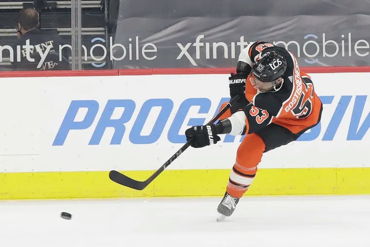 Flyers defenseman Shayne Gostisbehere shoots the puck against the New York Rangers on Saturday. The Flyers placed him on waivers Tuesday and appear to be setting up a trade.