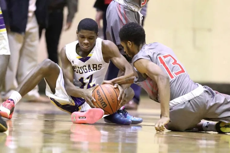 Hyseir Miller (left), shown fighting for a loose ball in a game against Imhotep Charter last season, scored 17 points in Martin Luther King's win against Overbrook on Monday.