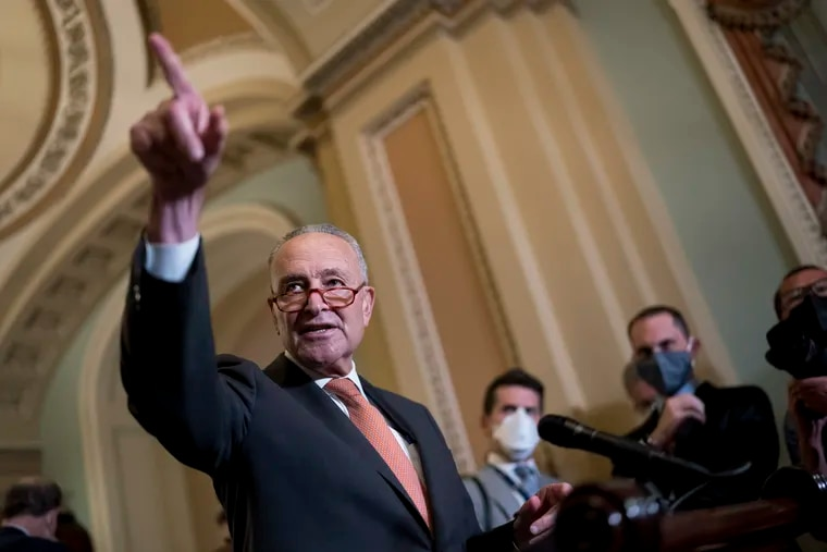 Senate Majority Leader Chuck Schumer, D-N.Y., takes questions as he speaks to reporters after a weekly policy meeting, at the Capitol in Washington, Tuesday, Sept. 21, 2021. Democratic congressional leaders, backed by the White House, have announced they will push ahead with a vote to fund the government and suspend the debt limit, all but daring Republicans to quit opposing the package or risk a fiscal crisis. (AP Photo/J. Scott Applewhite).