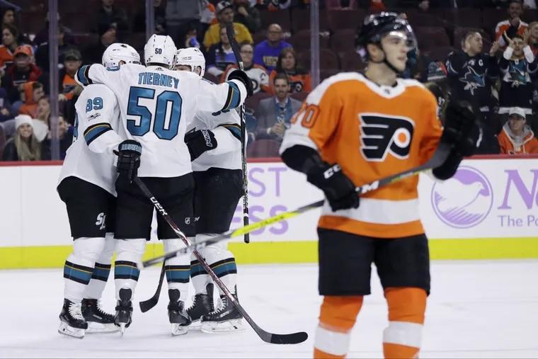 Flyers' Danick Martel and Sharks react to San Jose goal.