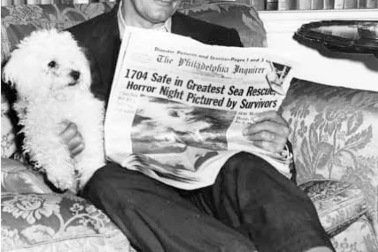 At home after surviving the sinking of the Andrea Doria, Mayor Richardson Dilworth relaxes with a poodle and The Inquirer's front-page article. The newspaper photos spurred calls and letters from citizens - concerned about the sofa.