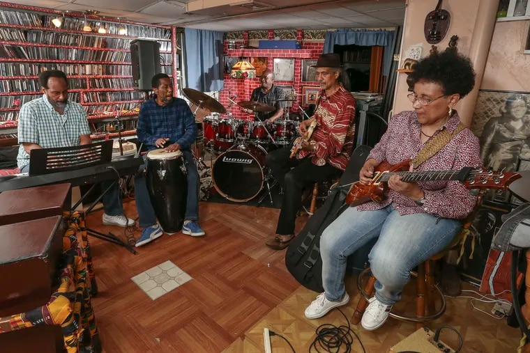Practicing in the Mount Airy basement of Dwight James on June 3, Sounds of Liberation will reunite for their first show in decades. (L-R)  Billy Mills, Lamont Smith, Dwight James, Charles Veasley, and Monnette Sudler.