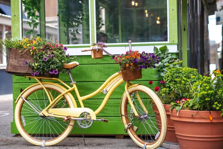 The yellow bike and floral arrangements designed by Maindencreek Co. in front of La Casita at Bar Bombon.