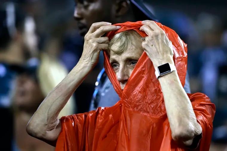 A fan preparing for severe weather before the Philadelphia Eagles game against  Atlanta Thursday, Sept. 6, 2018.