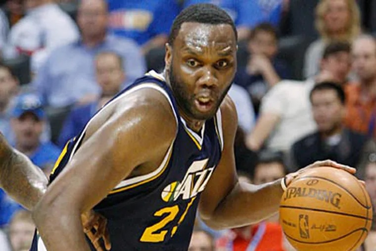 The Sixers could trade swingman Andre Iguodala for Jazz center Al Jefferson. (Sue Ogrocki/AP)