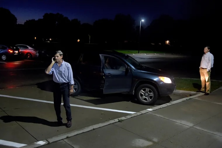 Former U.S. Rep. Joe Sestak (left) takes a phone call before leaving the Story County Democrats Fall Barbecue fund-raiser after speaking to voters there in Nevada, Iowa, on Sept. 22.