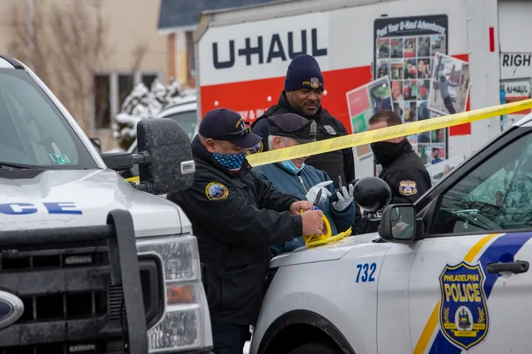Philadelphia police Crime Scene Unit officers investigate a dismembered body in the back of a U-Haul truck stopped on Kelvin Avenue in Northeast Philadelphia on Thursday morning.
