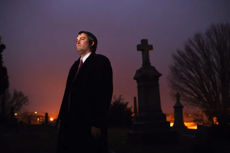 Brett Talley poses for a portrait at Washington's Holy Rood Cemetery in December 2014.