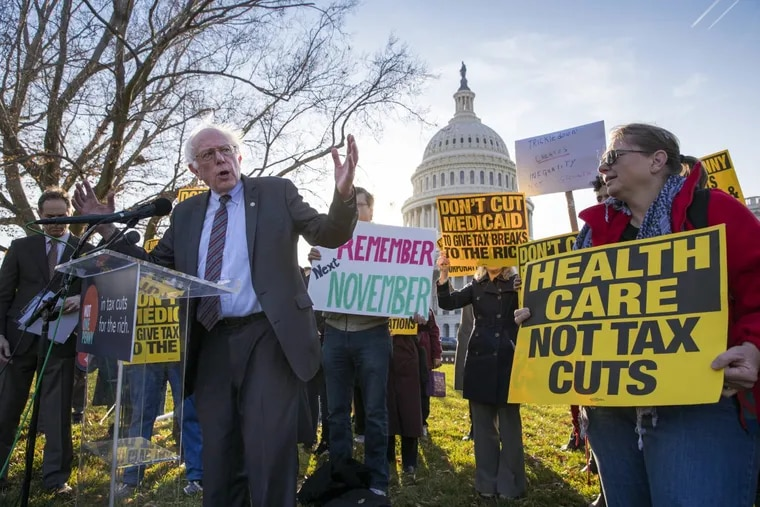 Sen. Bernie Sanders, I-Vt., joins protesters outside the Capitol as Republicans in the Senate work to pass their sweeping tax bill, a blend of generous tax cuts for businesses and more modest tax cuts for families and individuals, on Capitol Hill in Washington, Thursday, Nov. 30, 2017.