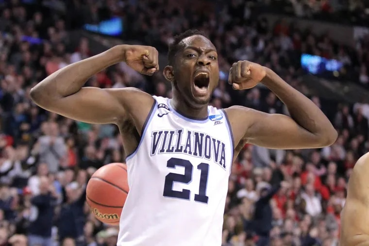 Dhamir Cosby-Roundtree of Villanova celebrates after a Donte DiVincenzo dunk against Texas Tech during the 1st half of the East Regionals of the NCAA Tournament at TD Garden on March 25, 2018.