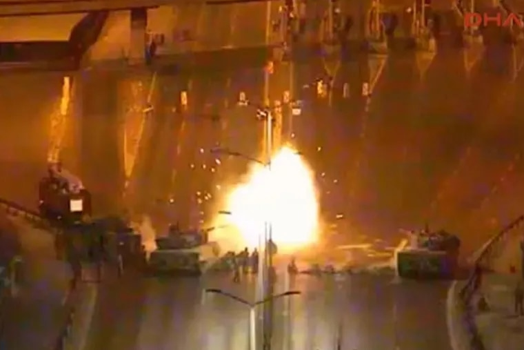 A CCTV video taken on July 15, 2016 shows the muzzle flash as a tank fires on a crowd of protesters at a roadblock on the Bosphorus Bridge in Istanbul. The bridge became a key battle site between military units mounting a coup and civilians who resisted. Dozens were killed on the bridge. (Video from DHA via AP)
