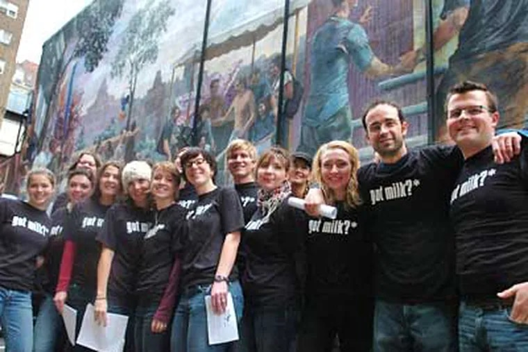 """A group of teachers from the Independence Charter School in front of a mural that depicts gay-rights events in the 1960s in Philadelphia. The instructors """"called out gay"""" to join a national protest against California's Proposition 8 gay-marriage ban. (Sarah J. Glover / Staff Photographer)"""