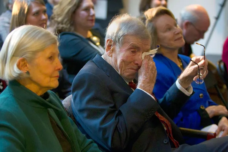 Henry Rowan wipes a tear while with wife Lee and daughter Virginia Rowan Smith at 2002 ceremonies marking the 20th anniversary of his gift.