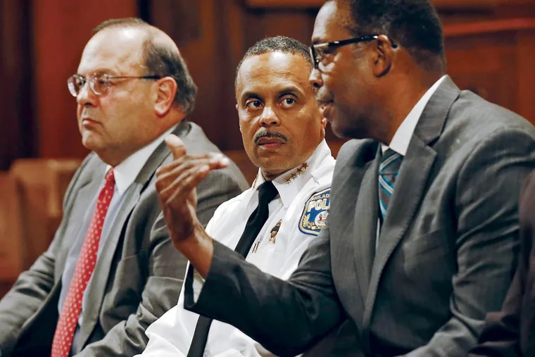 Philadelphia Police Commissioner Richard Ross (center) listens to Council President Darrell L. Clarke (right) with Councilman Allan Domb during a community meeting to discuss Rittenhouse Square security one week after a shooting.