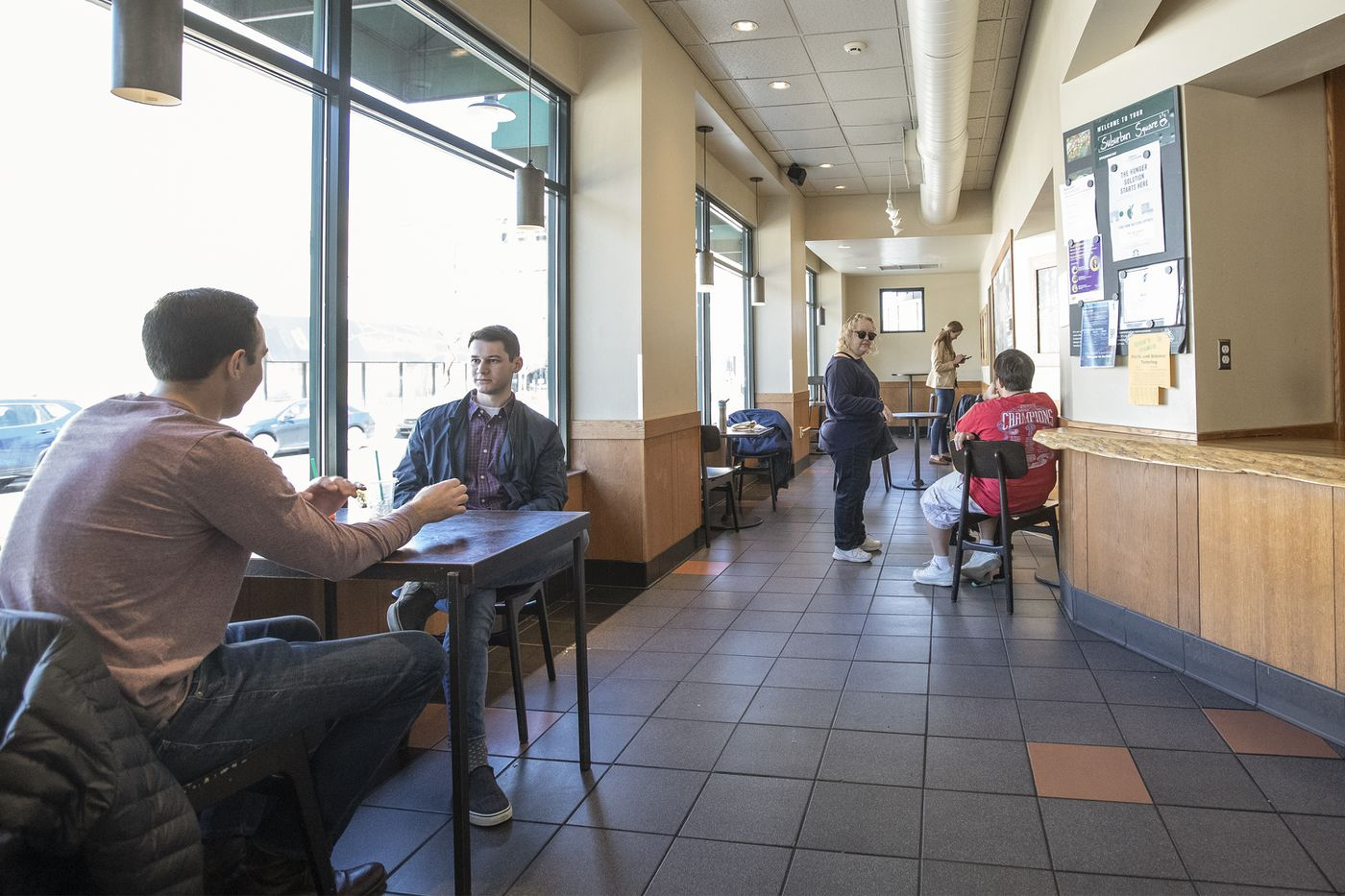 The Starbucks cafe in the Suburban Square shopping center in Montgomery County, Pa, was still open on Sunday, March 15, 2020, but the store had reduced their seating capacity to promote social distancing of six feet or more. The number of places to sit was severely reduced.