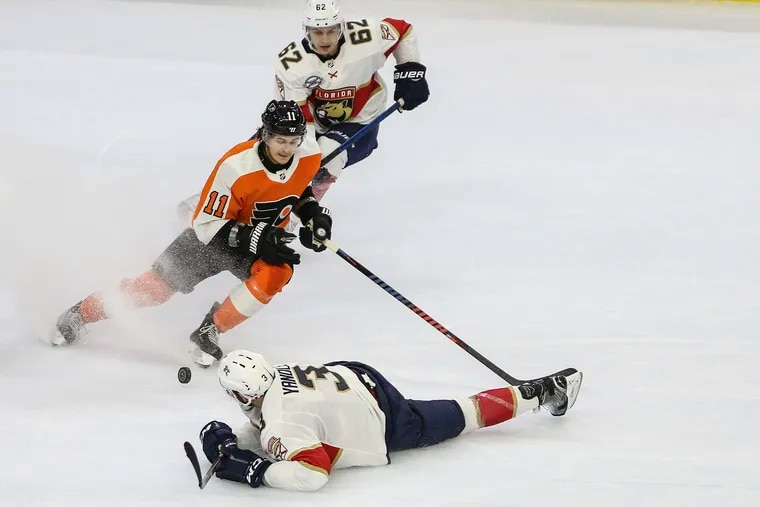 The Flyers' Travis Konecny skates between Panthers' Denis Malgin and Keith Yandle during the overtime at the Wells Fargo on Oct. 16, 2018. Flyers will reportedly sign Yandle on Wednesday.