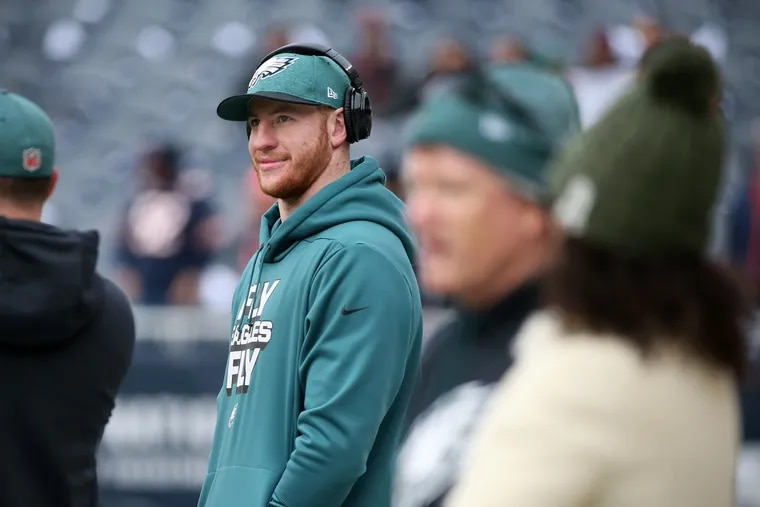 Carson Wentz watches warmups during a first-round playoff game against the Chicago Bears at Soldier Field in Chicago on Sunday, Jan. 6, 2019.