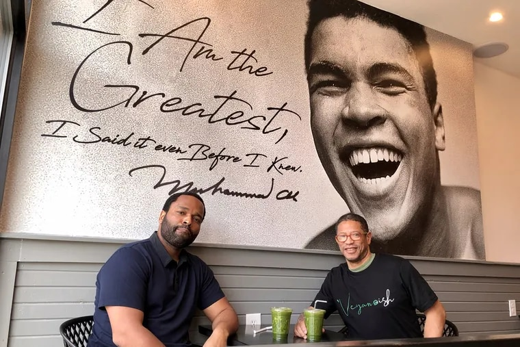 Owner Lamarr Ingram (left) and chef Todd Butler beneath a Muhammad Ali mural at Vegan-ish, 1214 N. 52nd St.