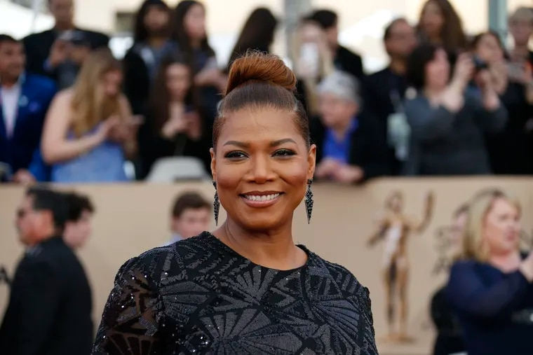 Queen Latifah arrives at the 22nd Annual Screen Actors Guild Awards at the Shrine Auditorium in Los Angeles on Saturday, Jan. 30, 2016.