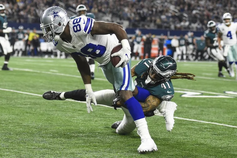 Eagles cornerback Ronald Darby tackles Cowboys wide receiver Dez Bryant for a 2-yard gain in the first quarter Sunday night.